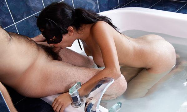 mexican-babe-giving-bathroom-blowjob